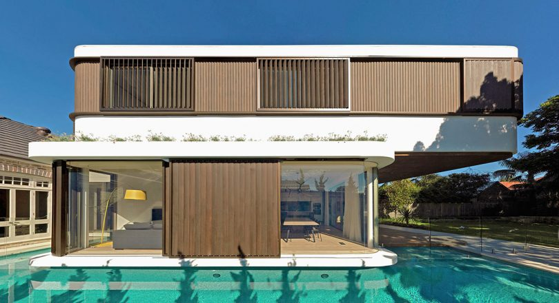 A Modern House with a Wraparound Swimming Pool