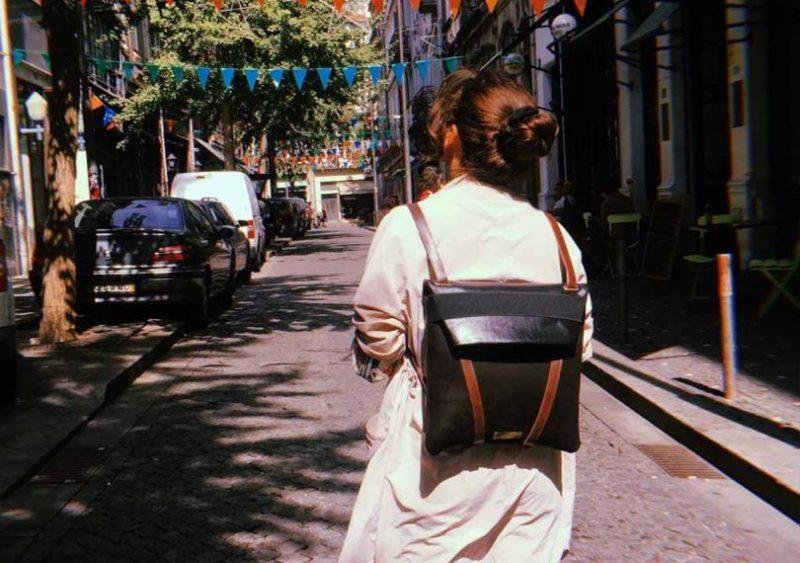 woman wearing the mariamaleta everyday backback walking down the street