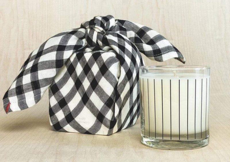 Studio Stockhome pinstripe candle with furoshiki tea towel wrapped next to it