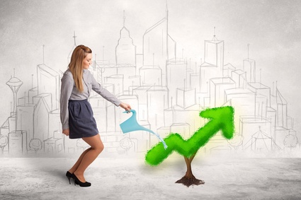 Business woman watering green plant arrow concept on background