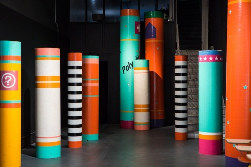 "Colorful pillars,      or ""sonotubes,     ""served as temporary wayfinding at the 1984 Summer Olympics. Photo: Laure Joliet Photography"