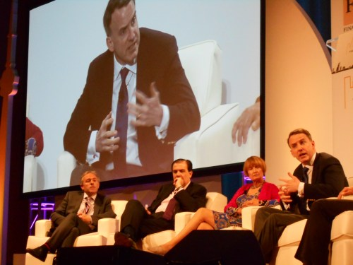 Economist Edward Glaeser makes a point during panel discussion on The Tale of Two Cities. To his right is Tessa Jowell member of House of Lords, Carlos Ivan Simonsen Leal, President of Fundacion Getulio Vargas in Rio de Janiero, and moderator Edward Luce of the Financial Times.