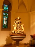 The Baptismal font cover carved by Grinling Gibbons.