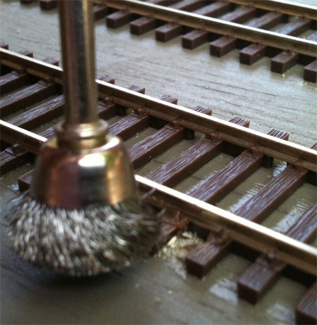 A wire brush in a motor tool can clean rail quickly.