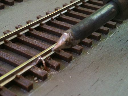 Apply heat to join wire to rail.
