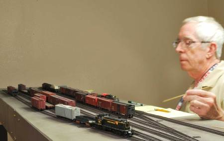 Mike sorts the out bound freight cars at the end of the session.