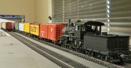 A switcher works a string of cars at the freight house.