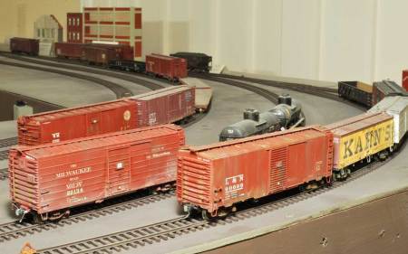The latest box cars from the weathering factory have been spotted in the team track yard. Read more about the weathering techniques used on these two models.