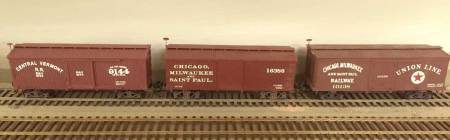 Three 28-foot box cars are seen here. The Central Vermont car at left is a modified BTS kit with Art Griffin decals applied. The CM&StP car in the center is also a modified B.T.S. kit. It began as a PRR box car. Art Griffin decals applied for the final lettering. The Chicago, Milwaukee, & St. Paul Union Line box car is an Art Griffin resin kit with decals also by Art.