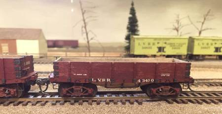 This is one of five Lehigh Valley coal hoppers scratchbuilt from wood using plans published in an 1888 issue of the National Car Builder. Michael built versions with both three-board and four-board sides.