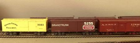 The two Grand Trunk Railway cars were scratchbuilt from styrene, which has become Michael's preferred medium for building box cars. The decals were purchased from Art Griffin along with photos of the prototype cars. Dimensions from equipment registers of the late 1800s were used to build these. The AT&SF box car is a 26-foot car built from a Trout Creek Engineering (LINK: http://www.troutcreekeng.com/ ) kit.