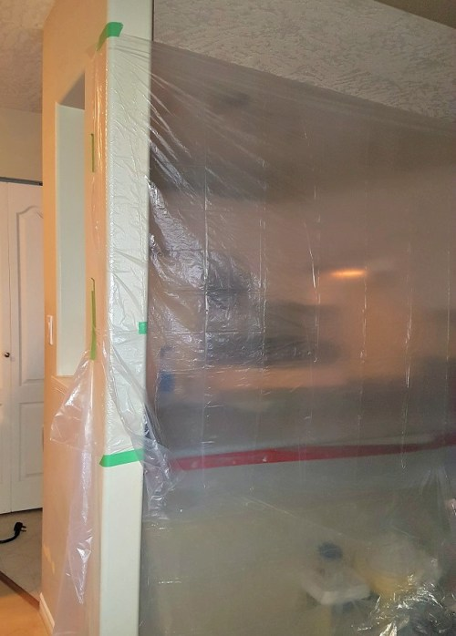 kitchen island taped off for application of Envirotex Lite Epoxy. DIY Epoxy counters