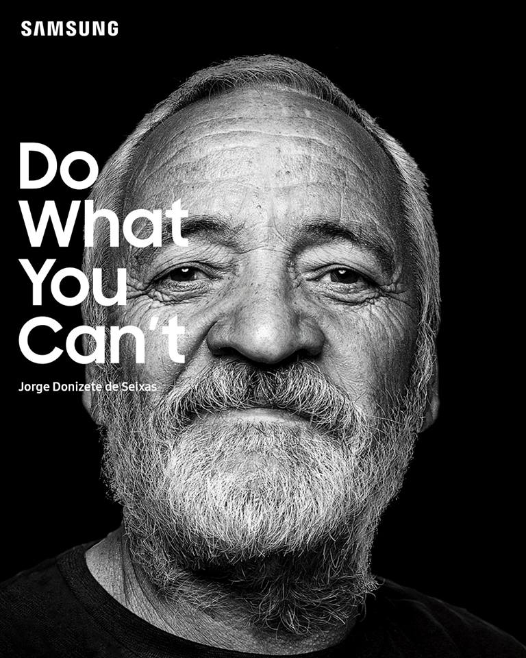 O homem Jorge Donizete de Seixas está sorrindo e no canto esquerdo superior da imagem há escrito a hastag Do What You Can't.