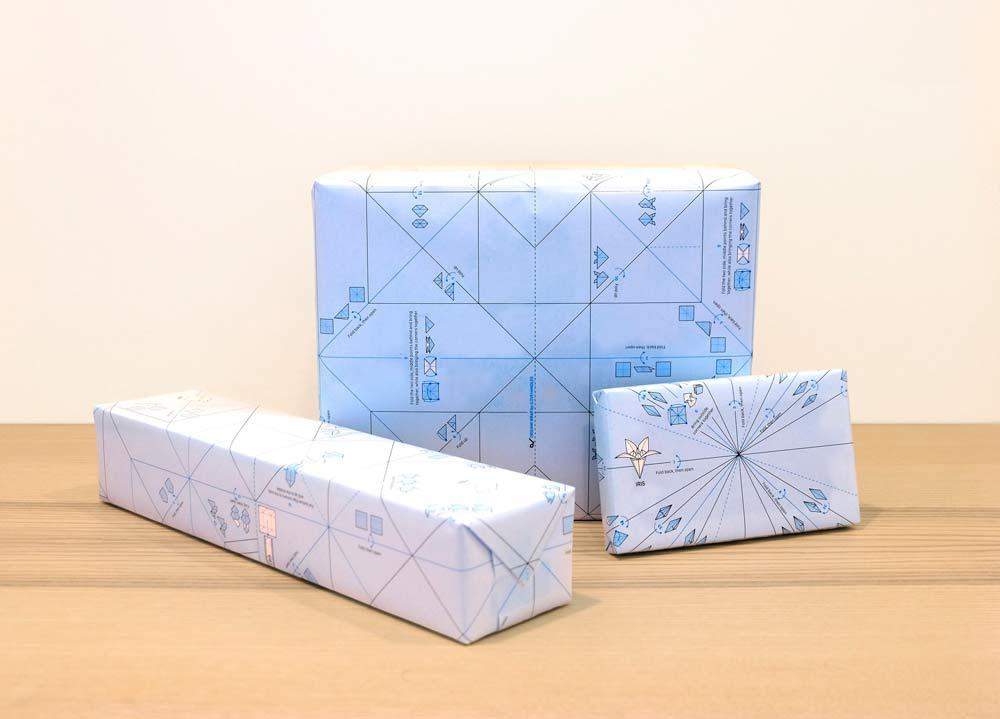 Presentes embalados com papéis de embrulho da ILOVEHANDLES