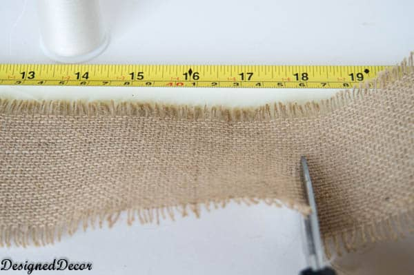 cutting and measuring the burlap for flowers