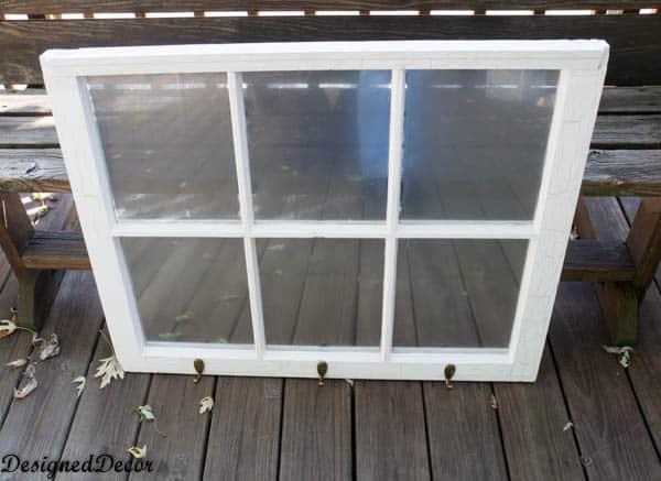 repurposed wood window into a coat rack