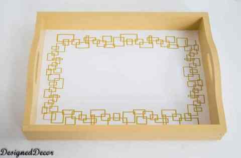 adding vinyl to decorate a serving tray-