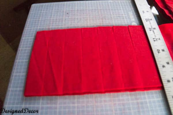 cutting strips for a Repurposed T-Shirt Rug-