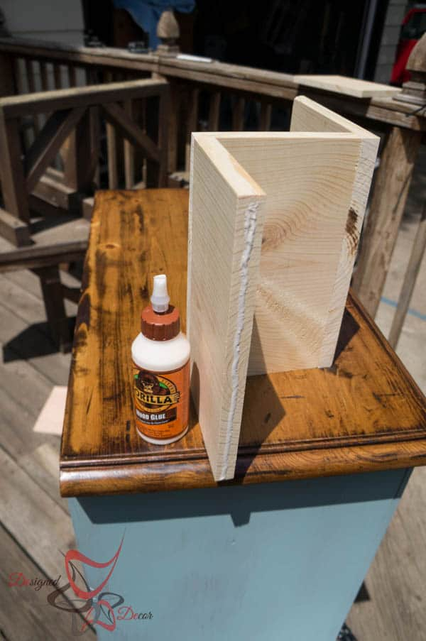 Using wood glue to secure wind bottle holder