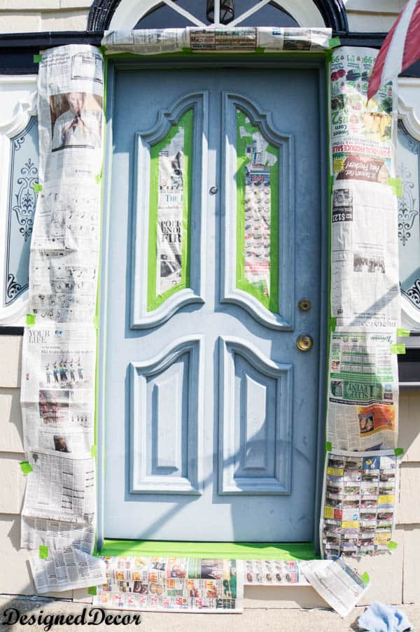 Taping off before spray painting  a front door