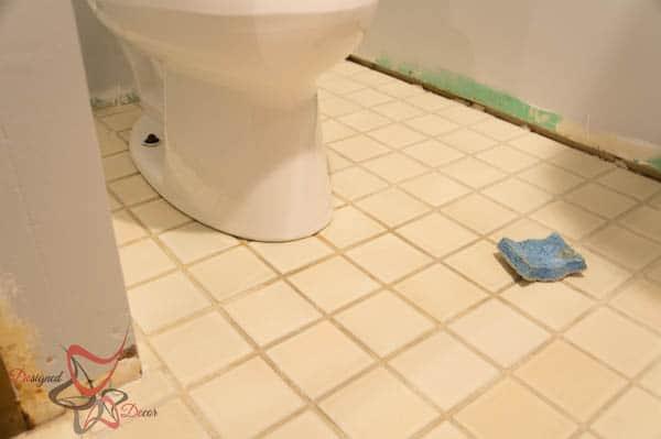 Basement Bathroom-Refreshing grout lines on the bathroom floor
