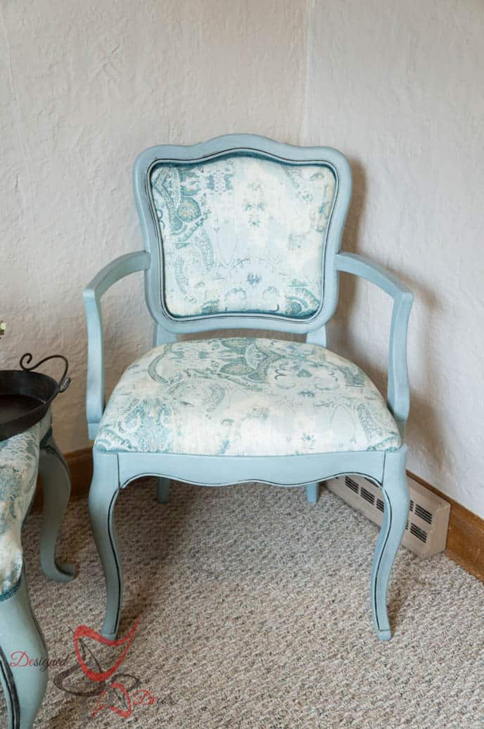 blue arm chair with paisley fabric on the seat cushion and back rest