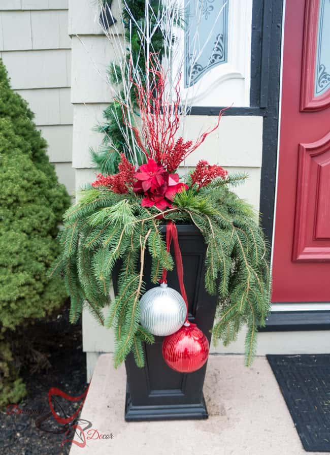 image of an outdoor planter with evergreens, branches and bulbs