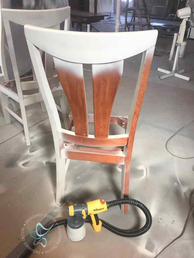image of a furniture paint sprayer and a wood chair being painted