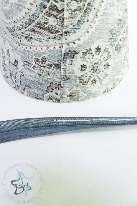 use fabric glue to secure folded ribbon