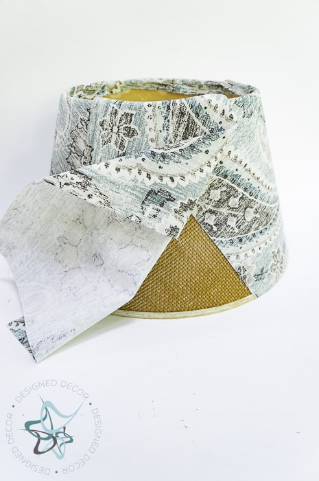 align fabric on lampshade and glue with fabric glue