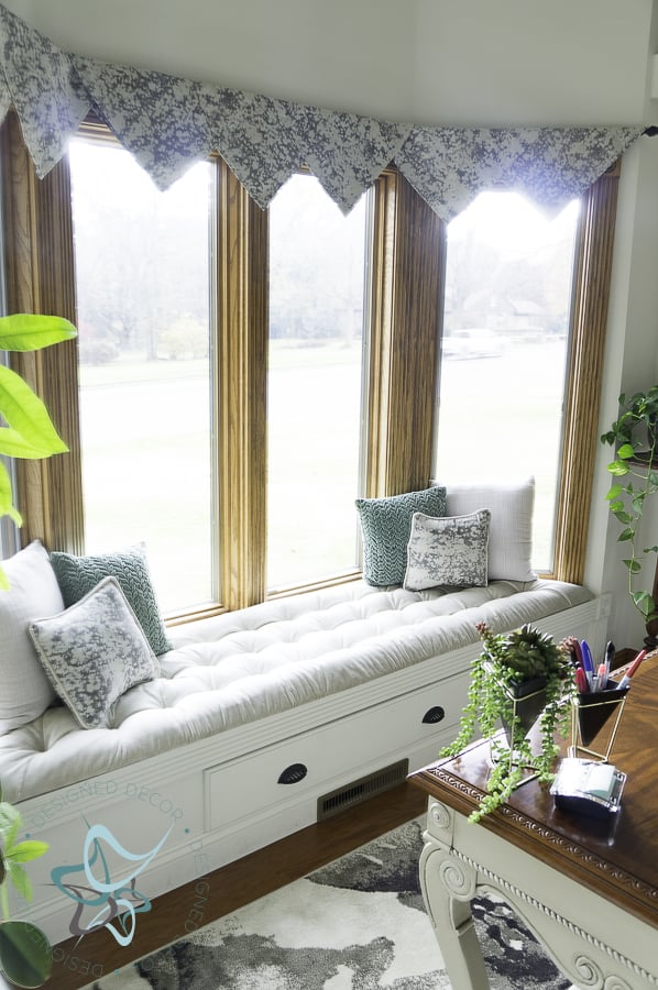 view of bay window with a built in bench seat