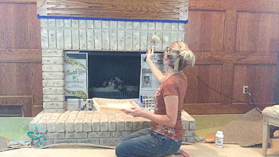 image of painting bricks on a fireplace