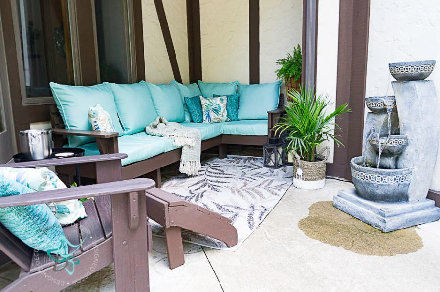 image of a patio seating area with a sectional sofa and Adirondack chair