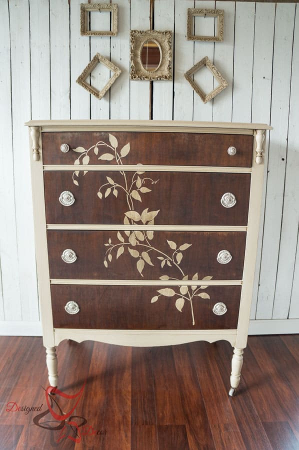 wood dresser painted with cream furniture paint and a stenciled vine of the front of the dresser drawers