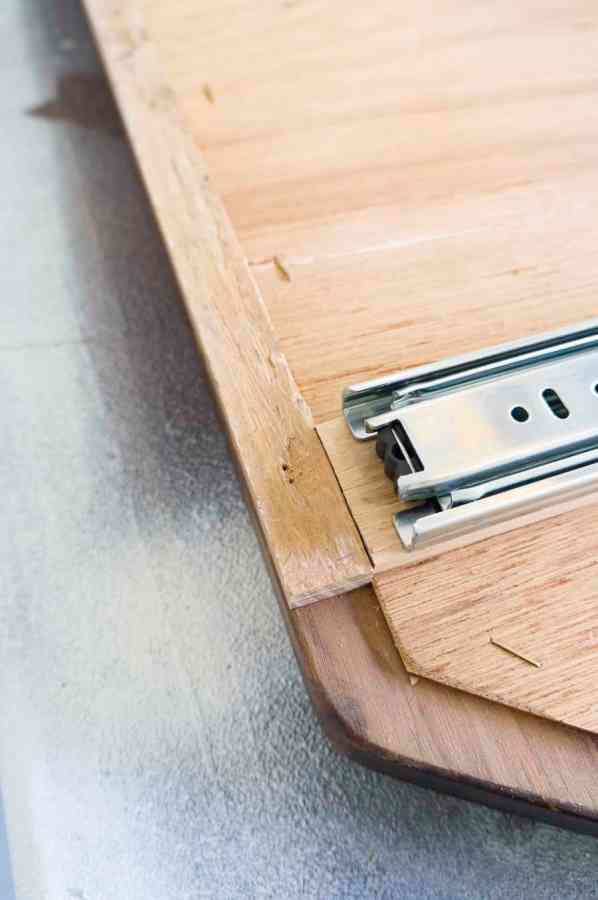 image of sliding hardware placed on the back of the wood mirror
