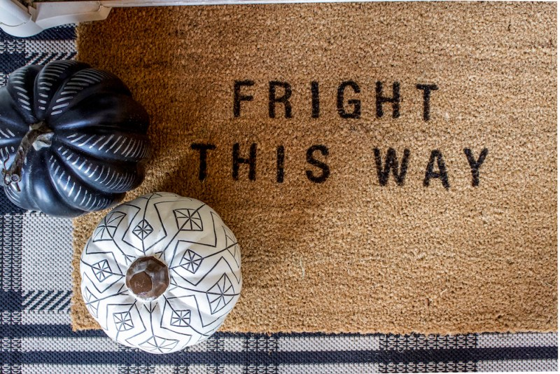 Simple & Spooky Halloween Decor | Decorate the front porch, a bookshelf, or entryway with these simple ideas! | Designed Simple | designedsimple.com