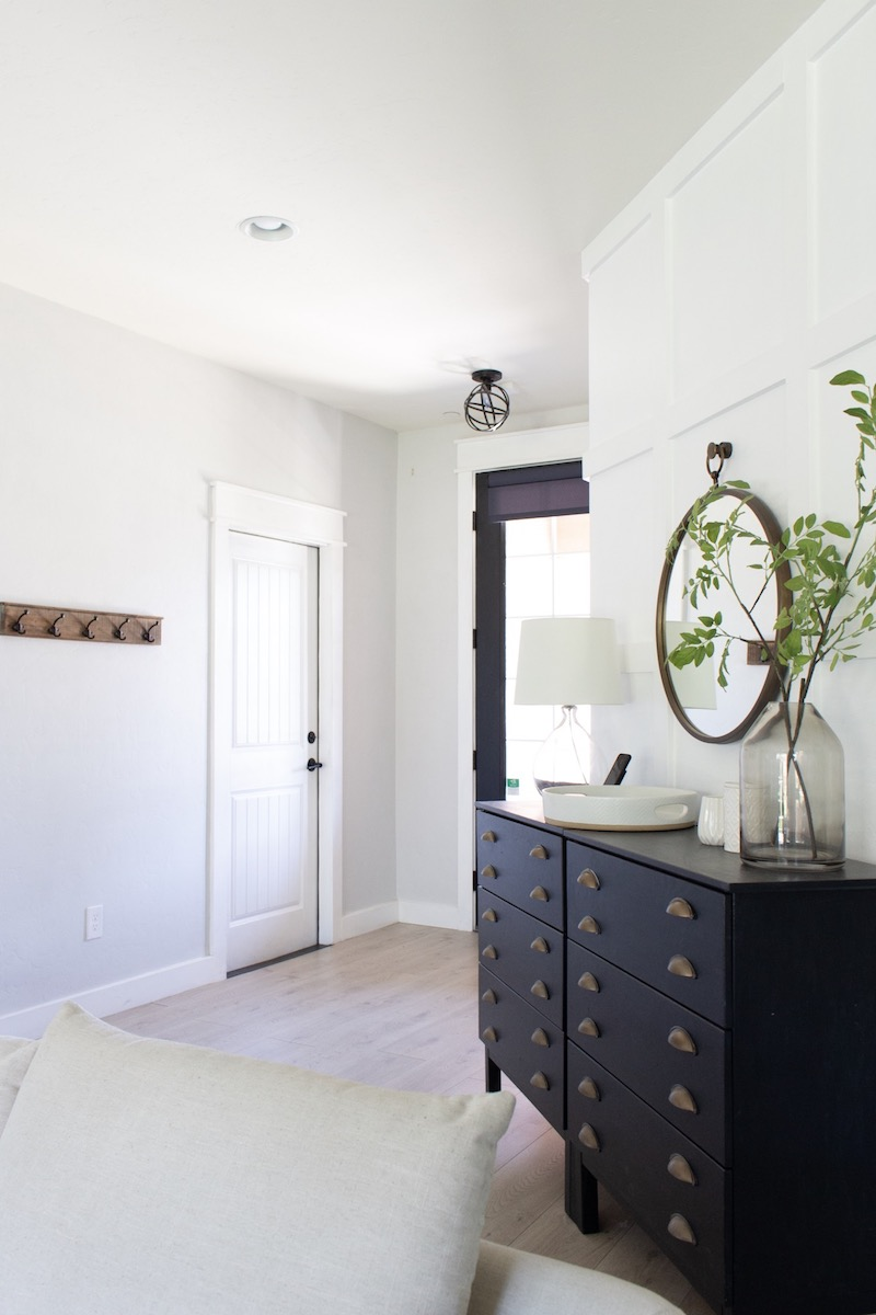 Updating our dark entryway with a glass front door was one of the best decisions we made in our home & I'm sharing all the details! | Designed Simple | designedsimple.com