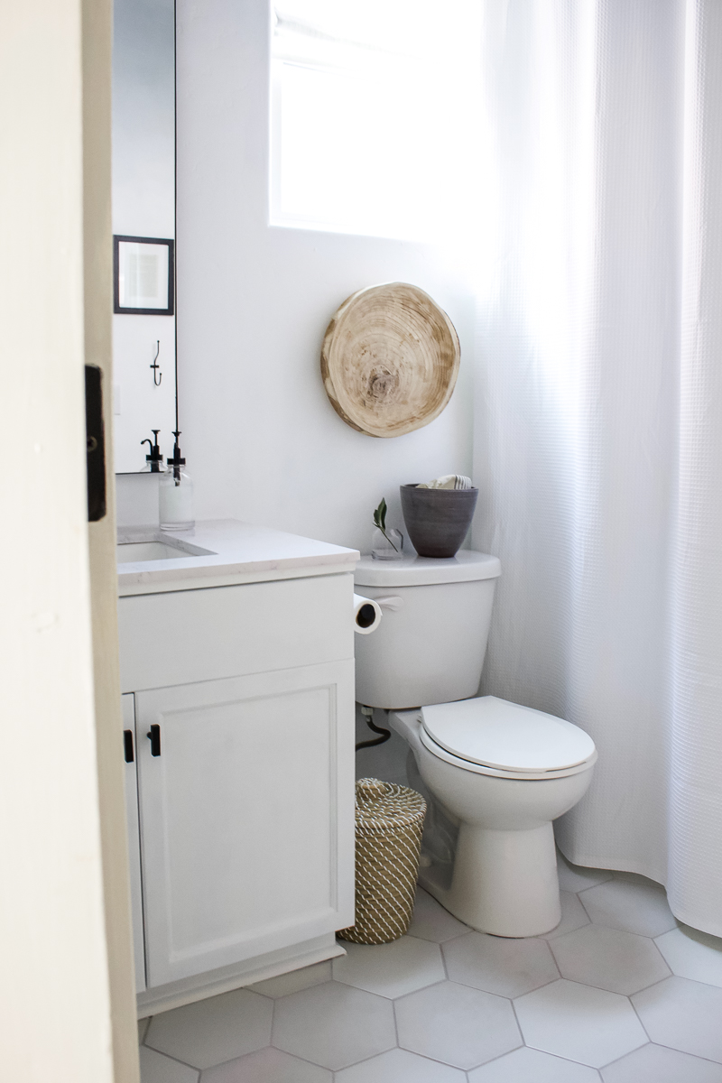 Budget Friendly Guest Bath Update | Six weeks and $500 dollars to complete transform our guest bathroom! | Designed Simple | designedsimple.com
