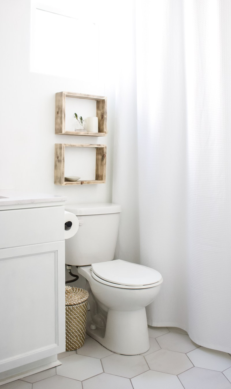 DIY Simple Box Shelves | Create simple shelves to decorate above the toilet with this easy DIY! | Designed Simple | designedsimple.com