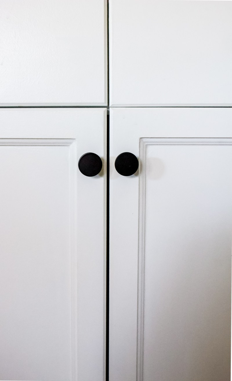 Sharing all of my tips for painting cabinets without sanding or a sprayer - I've used this technique 3 times in our house now and its great! | Designed Simple | designedsimple.com