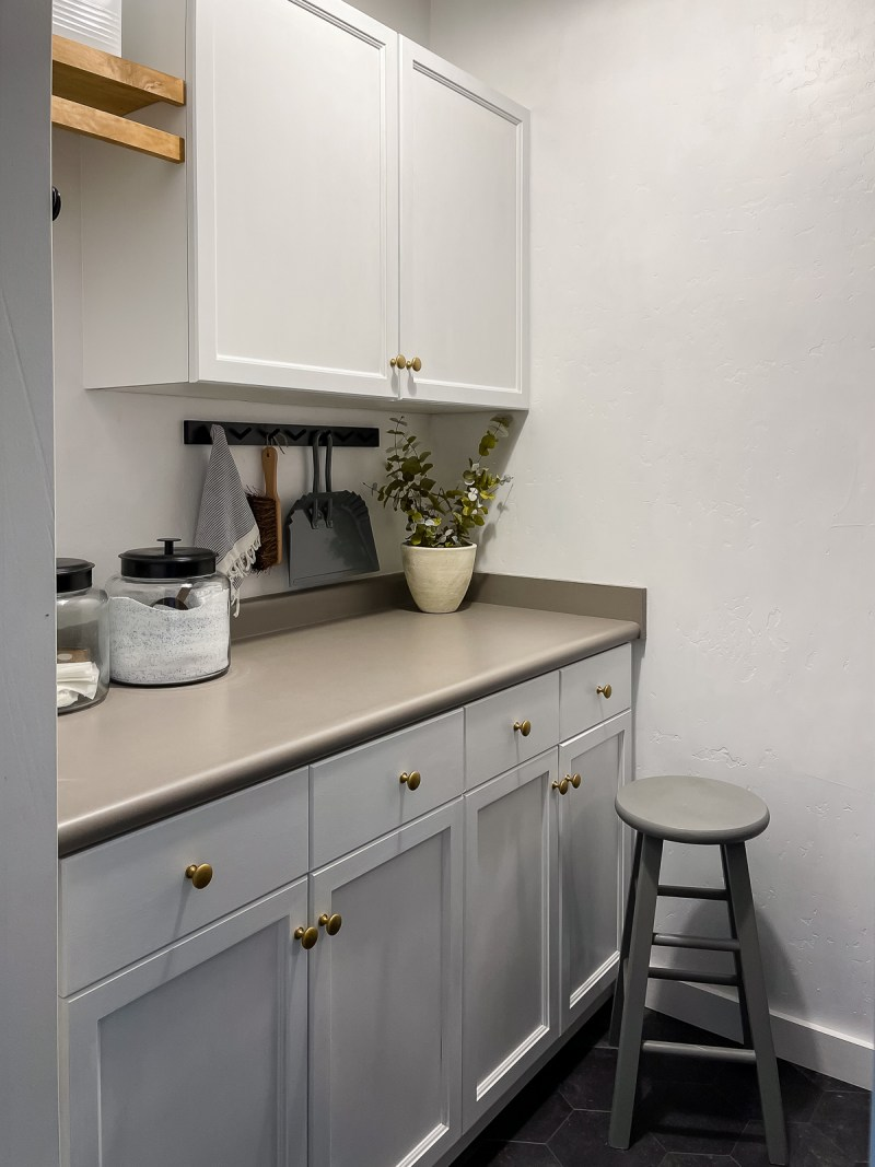 Sharing the reveal of our budget friendly laundry room! More storage, a fresh coat of paint, and a few DIY projects totally changed the look! | Designed Simple | designedsimple.com