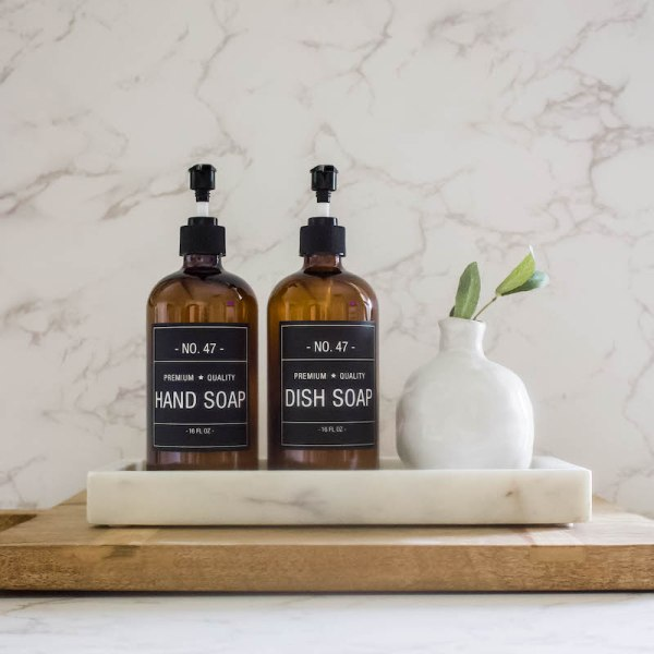 This stylish amber glass dish soap bottle features a simple and sophisticated label. Just add your favorite dish soap! Easy to refill, versatile, and adds style to your kitchen or bath.| Designed Simple