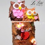 3D Owl Log Cake with built in flower lights