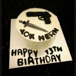 Gun and Sword Customized Cake