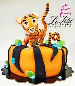 Tiger Print Fondant Cake With Tiger Topper.