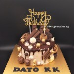 Drip Cake - Chocolate drip cake with chocolates. chocolate chip cookies and gold balls. Singapore Customized Cakes