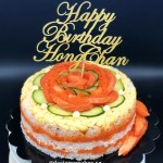 The Real Sushi Cake, with a lot of salmon sashimi, tamago, ebiko, kani with a customized cake topper. Singapore Customized Cakes.
