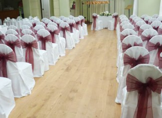 black organza sashes; white sashes; red chair covers; red organza sashes; white chair covers; pembroke lodge.