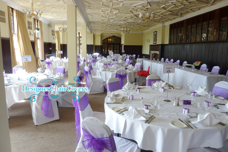 White Chair Covers With Cadbury Purple Organza Sashes