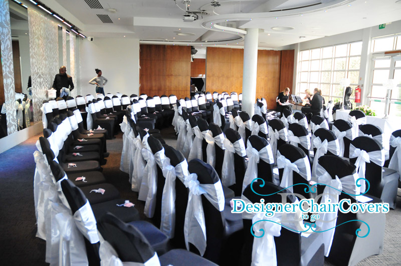 black chair covers white sashes